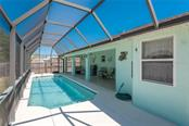Swimming Pool with patio area - Single Family Home for sale at 7718 36th Ln E, Sarasota, FL 34243 - MLS Number is A4181555