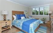 Bedroom 2 of 2 - Condo for sale at 6263 Midnight Pass Rd #101, Sarasota, FL 34242 - MLS Number is A4182245