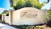 Front Entrance Sign - Single Family Home for sale at 7658 Trillium Blvd, Sarasota, FL 34241 - MLS Number is A4182608