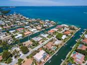 Aerial view looking southwest - Single Family Home for sale at 551 Putting Green Ln, Longboat Key, FL 34228 - MLS Number is A4183977