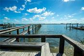 Private dock on Sarasota Bay. - Single Family Home for sale at 8319 Midnight Pass Rd, Sarasota, FL 34242 - MLS Number is A4184004