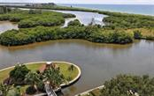Aerial view of island with gazebo - Condo for sale at 9397 Midnight Pass Rd #403, Sarasota, FL 34242 - MLS Number is A4185842