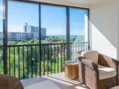 Gulf views from enclosed balcony - Condo for sale at 6236 Midnight Pass Rd #406, Sarasota, FL 34242 - MLS Number is A4188093