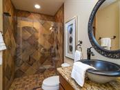 Downstairs full bathroom with standup shower and beautiful bowl sink. - Single Family Home for sale at 1884 Grove St, Sarasota, FL 34239 - MLS Number is A4189365