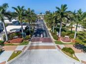 Community entrance driveway - Condo for sale at 19 Whispering Sands Dr #205, Sarasota, FL 34242 - MLS Number is A4189914