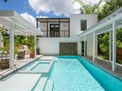 Enjoy morning swims in the waterfall pool which is shared between the detached guest house and main home! - Single Family Home for sale at 2315 Mietaw Dr, Sarasota, FL 34239 - MLS Number is A4191514