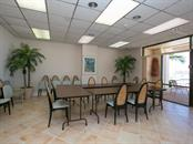 Building community room overlooking pool & Gulf - Condo for sale at 1750 Benjamin Franklin Dr #5g, Sarasota, FL 34236 - MLS Number is A4192160