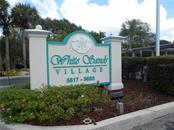 Community entrance - Condo for sale at 5661 Midnight Pass Rd #403, Sarasota, FL 34242 - MLS Number is A4198451