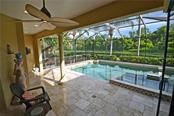 salt-water swimming pool and spa with lake views - Single Family Home for sale at 4616 Tuscana Dr, Sarasota, FL 34241 - MLS Number is A4200517