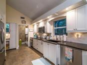 Kitchen - Single Family Home for sale at 5194 Siesta Woods Dr, Sarasota, FL 34242 - MLS Number is A4206364