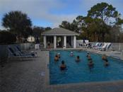 So much to do....if you'd like!  This is the Thursday morning water aerobics class!  This is the closest of the 3 heated pools for your enjoyment at St. Andrews Park!  It is within walking distance of this great unit! - Condo for sale at 815 Montrose Dr #202, Venice, FL 34293 - MLS Number is A4206556