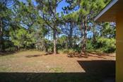 Back yard - Single Family Home for sale at 1876 Bushnell Ave, North Port, FL 34286 - MLS Number is A4207073