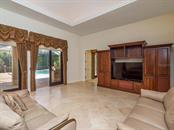 Family Room - Single Family Home for sale at 7715 Donald Ross Rd W, Sarasota, FL 34240 - MLS Number is A4208499