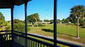 View of Village Green Public Golf Course from deck off of Living room - Condo for sale at 3465 Bee Ridge Rd #323, Sarasota, FL 34239 - MLS Number is A4213622