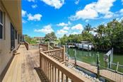 Rear deck to lifts and water - Single Family Home for sale at 432 Sorrento Dr, Osprey, FL 34229 - MLS Number is A4402898