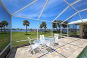 Large sunny screened patio - Single Family Home for sale at 1778 Bayshore Dr, Englewood, FL 34223 - MLS Number is A4405962