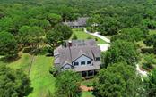 Two buildings: The main home hosting 4 bedrooms + 4.5 baths.  The second building with 6 stables, an expansive art studio, tack room and 3-car garage (all under air)! - Single Family Home for sale at 7866 Saddle Creek Trl, Sarasota, FL 34241 - MLS Number is A4407172