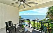 Balcony w/industrial fan & endless views. - Single Family Home for sale at 2145 Alameda Ave, Sarasota, FL 34234 - MLS Number is A4414337