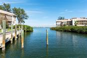 Saltwater canal to Palma Sola Bay. - Condo for sale at 3920 Mariners Way #323a, Cortez, FL 34215 - MLS Number is A4416115