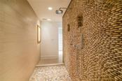 River rock shower in master bath - Townhouse for sale at 222 Beach Rd #4, Sarasota, FL 34242 - MLS Number is A4416747