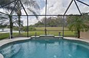 Salt water pool.  The two palms in the inside planters have been removed. - Villa for sale at 252 Fairway Isles Ln, Bradenton, FL 34212 - MLS Number is A4417217