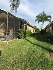 Side of home.  All landscaping taken care of by association. - Villa for sale at 252 Fairway Isles Ln, Bradenton, FL 34212 - MLS Number is A4417217