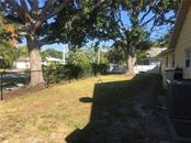 Side yard is fenced for child play or your four legged friend(s). - Single Family Home for sale at 1611 82nd St Nw, Bradenton, FL 34209 - MLS Number is A4417607