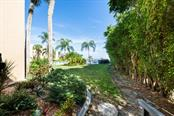Your own walkway to the pool and dock. - Condo for sale at 450 Gulf Of Mexico Dr #b107, Longboat Key, FL 34228 - MLS Number is A4418457