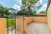 One of two front porches. - Villa for sale at 5235 Myrtle Wood #18, Sarasota, FL 34235 - MLS Number is A4418558