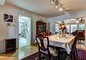 The formal dining area is spacious enough to comfortably place large dining room furniture. - Single Family Home for sale at 1509 Flower Dr, Sarasota, FL 34239 - MLS Number is A4421898