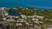 Aerial view of your building in Whispering Sands. - Condo for sale at 225 Hourglass Way #208, Sarasota, FL 34242 - MLS Number is A4425323