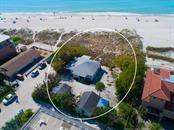 Single Family Home for sale at 104 34th St, Holmes Beach, FL 34217 - MLS Number is A4427813