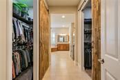 Custom barn doors highlight his and hers closets which include closet systems - Single Family Home for sale at 595 Fore Dr, Bradenton, FL 34208 - MLS Number is A4428657