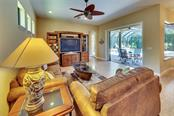 Large family room overlooking oversized lanai - Single Family Home for sale at 3753 Eagle Hammock Dr, Sarasota, FL 34240 - MLS Number is A4431001