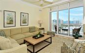 Living room - high ceilings, crown molding, hardwood floor and a view of the bay - Condo for sale at 1350 Main St #1500, Sarasota, FL 34236 - MLS Number is A4433444