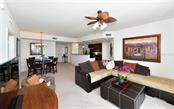 Living room, dining room and kitchen - Condo for sale at 800 N Tamiami Trl #602, Sarasota, FL 34236 - MLS Number is A4436915