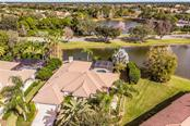 Single Family Home for sale at 6847 Turnberry Isle Ct, Lakewood Ranch, FL 34202 - MLS Number is A4455880