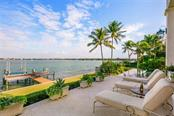 Enjoy frequent dolphin sightings from the terrace overlooking Sarasota Bay. Terrace offers an outdoor kitchen with refrigerator, grill and full pool bath. - Single Family Home for sale at 901 Norsota Way, Sarasota, FL 34242 - MLS Number is A4456224