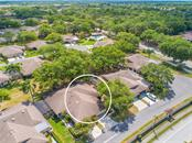 Aerial View of 4335 Rum Cay w/Greenbelt and Pool Beyond - Villa for sale at 4335 Rum Cay Cir, Sarasota, FL 34233 - MLS Number is A4463762