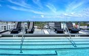 Enjoy time to take a dip and relax along the roof top pool deck. - Condo for sale at 1350 5th Street #301, Sarasota, FL 34236 - MLS Number is A4466172