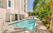 Enjoy a dip in the salt water pool, with its nearby spa and grilling area. - Condo for sale at 609 Golden Gate Pt #201, Sarasota, FL 34236 - MLS Number is A4468917