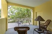 2nd bedroom balcony - Condo for sale at 1308 Old Stickney Point Rd #W24, Sarasota, FL 34242 - MLS Number is A4471155