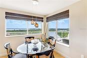 Breakfast bar to open kitchen - Condo for sale at 1300 Benjamin Franklin Dr #708, Sarasota, FL 34236 - MLS Number is A4471978