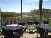 Clubhouse deck. - Condo for sale at 977 Sandpiper Cir #977, Bradenton, FL 34209 - MLS Number is A4474554