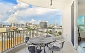 Westerly view from the curved terrace - Condo for sale at 1771 Ringling Blvd #1110, Sarasota, FL 34236 - MLS Number is A4474683