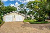 Two Car Garage with Guest House and Expansive Circular Driveway - Single Family Home for sale at 1595 Bay Point Dr, Sarasota, FL 34236 - MLS Number is A4479218