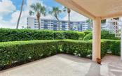 Third lanai at ground level accessed via stairway off bayside lanai. - Condo for sale at 1240 Dolphin Bay Way #201, Sarasota, FL 34242 - MLS Number is A4480544