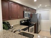 Updated Kitchen with Granite Counters - Condo for sale at 9011 Midnight Pass Rd #328, Sarasota, FL 34242 - MLS Number is A4483601