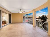 Expansive veranda for year round outdoor entertaining and enjoyment. - Condo for sale at 14021 Bellagio Way #407, Osprey, FL 34229 - MLS Number is A4487552
