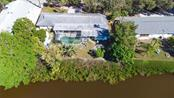 Two separate units with shared pool. - Duplex/Triplex for sale at 6536 Peacock Rd, Sarasota, FL 34242 - MLS Number is A4490204
